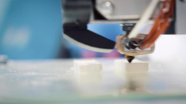 Three dimensional printer during work in school laboratory, 3D plastic printer, 3D printing video