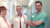 Three Doctors standing in hallway of hospital video