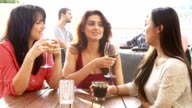 Three Female Friends Enjoying Drink At Outdoor Rooftop Bar video