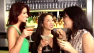 Three Female Friends Enjoying Drink In Cocktail Bar video