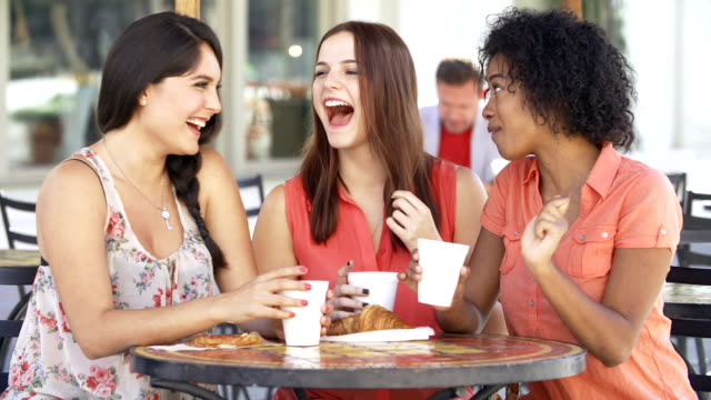 Three Female Friends Meeting In Café video