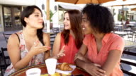 Three Female Friends Taking Selfie In Café video