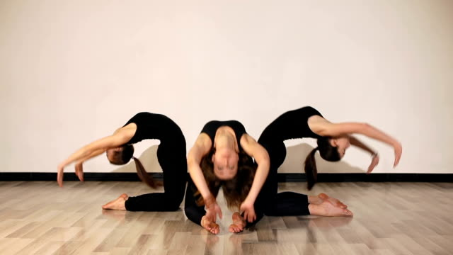 Three flexible girls doing backbend on the floor video
