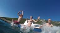 POV Three friends jumping off boat into the sea video