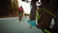 POV Three friends riding bikes through countryside video