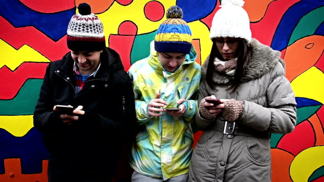 Three friends with phones video