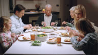 Three generation family eating dinner video