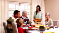 Three generation family having christmas dinner together video