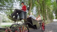 SLO MO TS Three generation family on horse carriage ride video