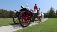DS Three generation family riding in a carriage around a castle video