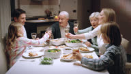 Three generation toast at the dinner table video