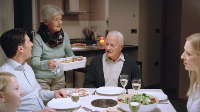 Three generations eating dinner and celebrating video