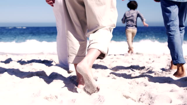 Three generations family running to the beach video