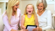 Three Generations of Females with Wireless Tablet video