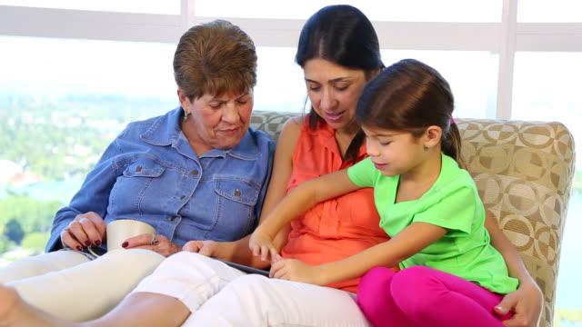 Three generations of latina hispanic women on sofa video