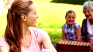 Three generations of women having a picnic video
