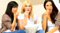 Three Girlfriends Watching Scary Movie with Popcorn video