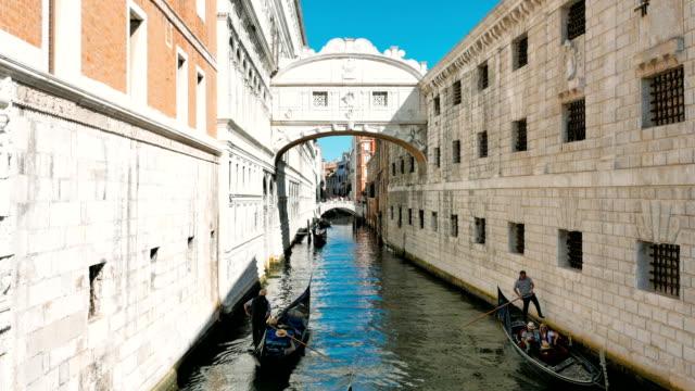 Three Gondolas in the canal, bridge, Venice, city of lovers video