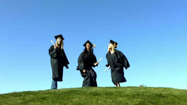 Three graduates jumping and celebrating video