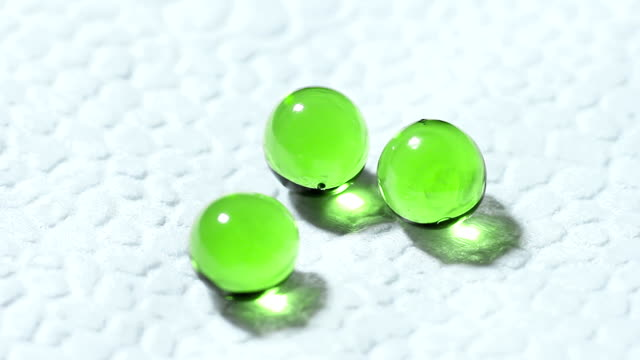 Three Green Transparent Tablets Rotate on a White Background video