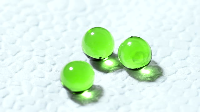 Three Green Transparent Tablets Rotate on White Background video
