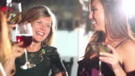 Three happy multi-ethnic women drinking at a party video