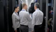 LD Three IT engineers talking in server room video