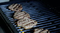 Three Juicy Burgers Sizzling on the Grill video