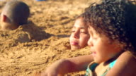 Three kids buried in sand video