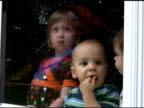 Three Kids looking through glass with rain 2 NTSC video