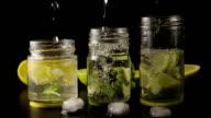 Three lemonade in jars super slow motion video