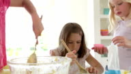 Three Little Girls Making Cake Together video