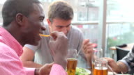 Three Male Friends Enjoying Lunch At Rooftop Restaurant video