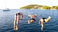 SLO MO Three men jumping into the sea video