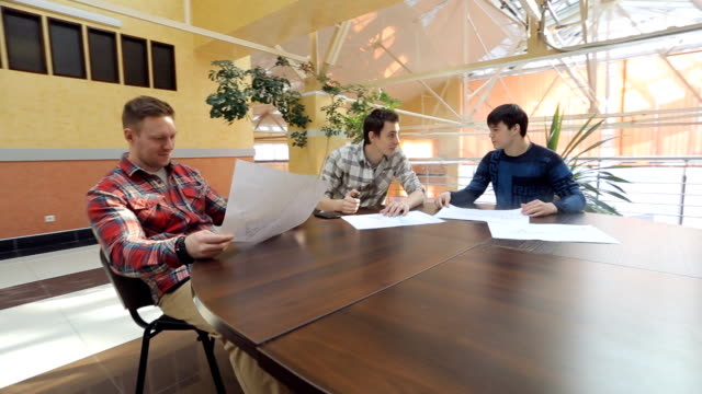 Three Men start up specialist discuss project at table video
