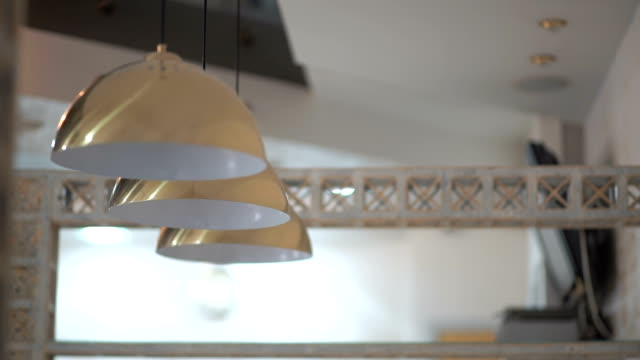 Three modern lamps under the ceiling video