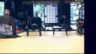 Three monks began to praying in a Japanese temple video