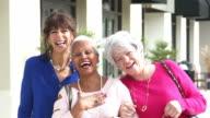 Three multi-ethnic senior women on city sidewalk video