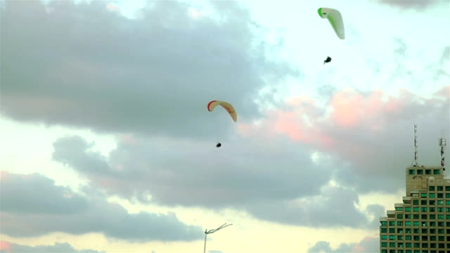 Three Paraplans in the sky over city video