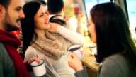 Three people having tea at cabin coffee shop. video