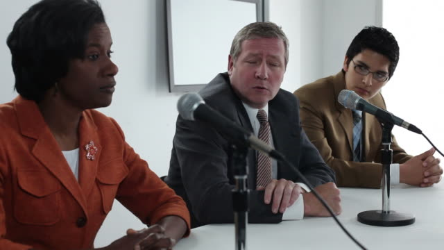 Three people participate in a panel discussion video
