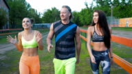 Three people walking in a park, getting some exercise video