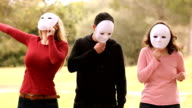 three people with masks and different emotions video