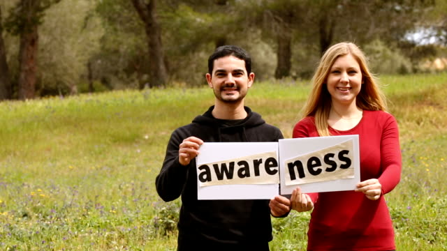 three persons with self-made signboards with conceptual puzzle words video
