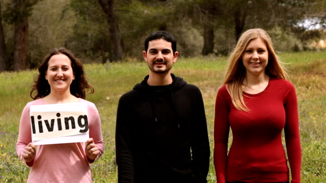 three persons with self-made signboards with conceptual words video
