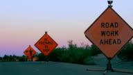Three Road Hazard Signs Warn Motorists of Construction Ahead video