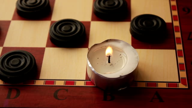 Three round candles on a black background video