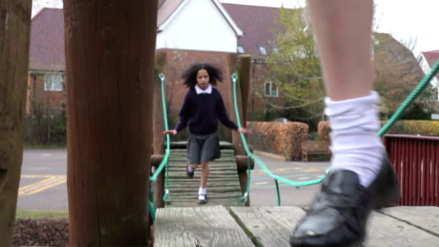 Three Schoolgirls Playing On Climbing Equipment video