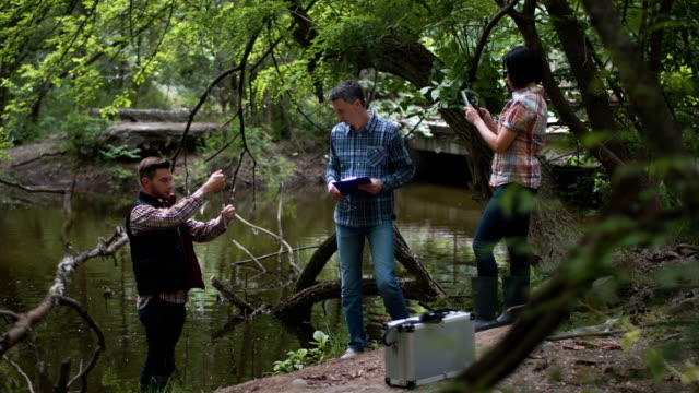 Three scientists exploring water in lake video