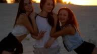 Three sexy girls on the beach at sunset video